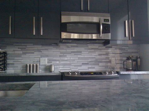 grey kitchen with granite coutertop