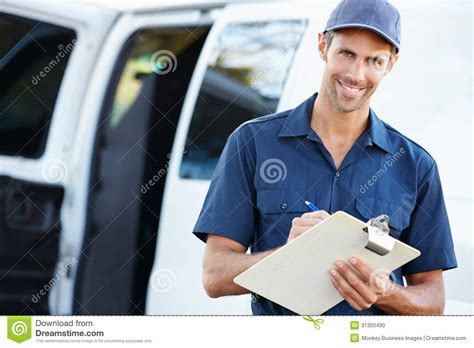 Delivery Driver by Portrait Of Delivery Driver With Clipboard Stock Photo Image 31350490