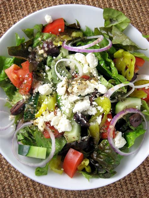 greek salads tossed greek salad with greek vinaigrette a hint of honey