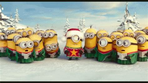 minion christmas caroling gif minion christmas carol discover share gifs