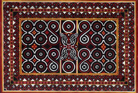 Kain Tenun Ikat Songket Tumpal 8 menggambar ragam hias geometris