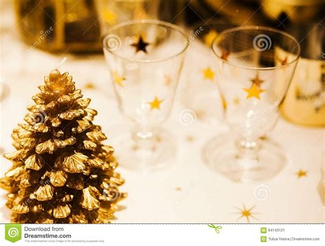 festive decorations christmastime table setting with golden festive