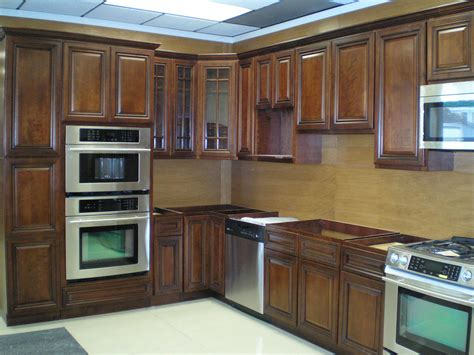 wood for kitchen cabinets dark wood kitchen cabinets