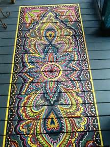 Faux rug painted on wooden porch in bright colors via flickr