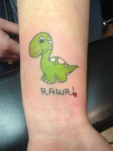 small weird tattoos small green dinosaur on left wrist tattoos
