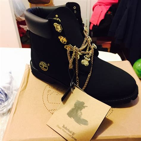 32 timberland boots timbs with gold chains from
