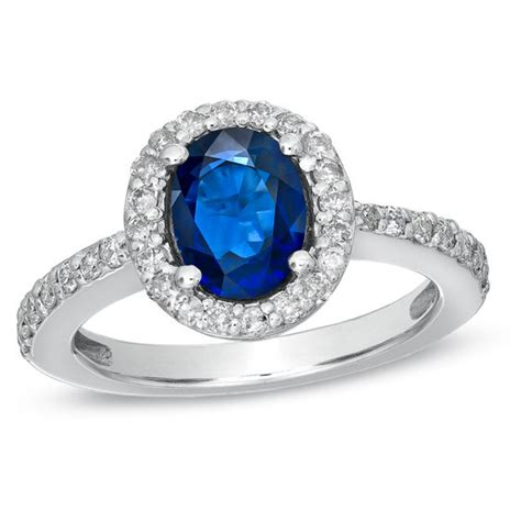 Blue Sapphire 12 3 Ct oval blue sapphire and 1 2 ct t w frame