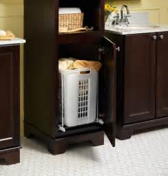 bathroom storage cabinet with laundry bin laundry her pull out bathroom vanities and sink