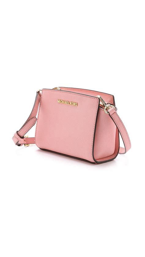 Michaelkors Mini Messenger Pink lyst michael michael kors selma mini messenger bag