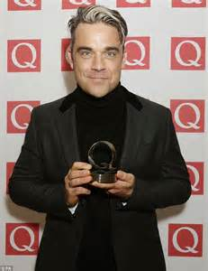 Someone Doesnt Like Robbie Williams by Robbie Williams Says He S Hooked On Fatherhood Daily