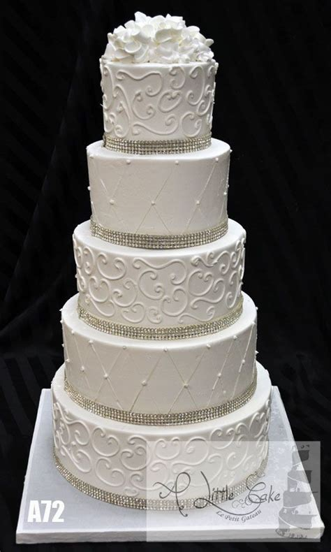 Buttercream iced wedding cake with rhinestone bands