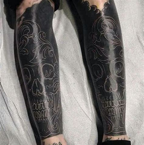 tattoo sleeve cover the new trend is called blackout tattoos pics