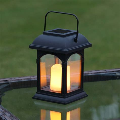 solar led candle l black solar candle lantern flickering amber led 15cm