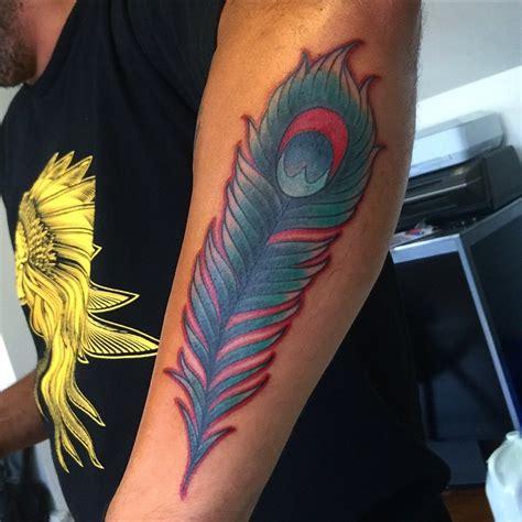 peacock feather tattoo upper arm 45 awesome peacock feather tattoo ideas golfian com