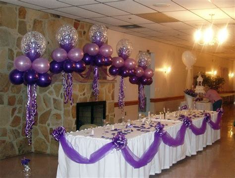 purple balloon wedding arches decorated   tan tuxedo wedding with purple tie floating candles