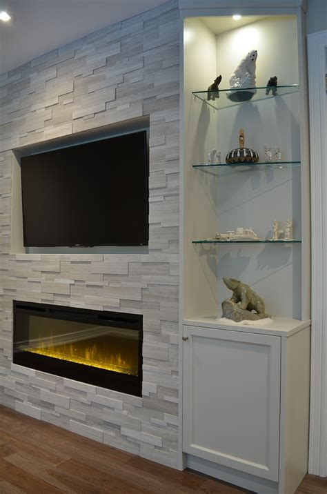 custom stone fireplace tv wall s d m custom finish one end of fireplace wall with custom cabinetry