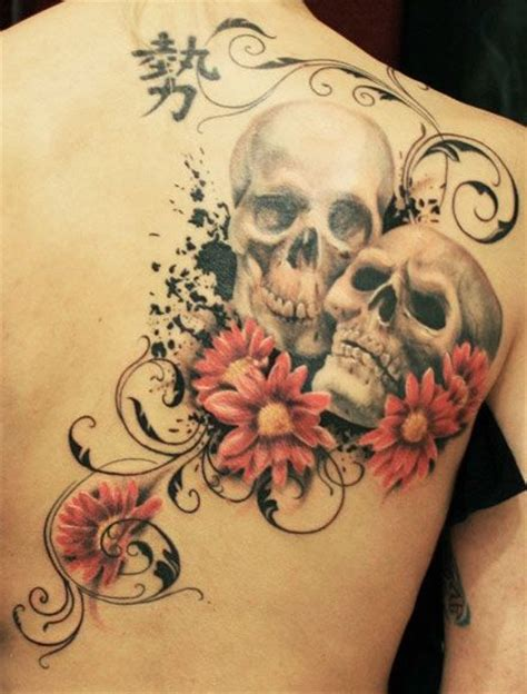 death skulls couple tattoo with flowers on back