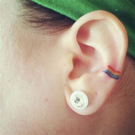 small rainbow tattoo fall in with these 13 beautiful pride tattoos brit co