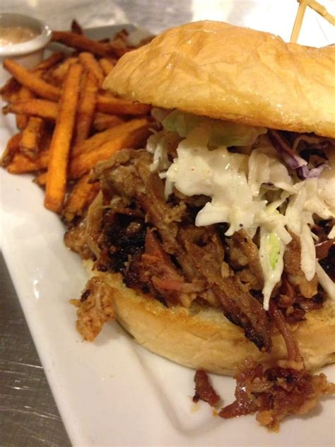 pour house chico pulled pork sandwich with sweet potato fries ohhh yessss please yelp