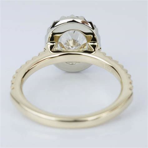 oval halo engagement ring in yellow white gold