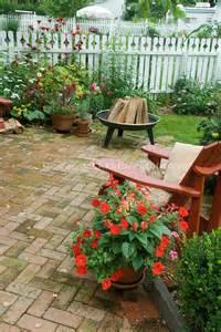 Is It Legal To Burn Wood In Backyard Backyard Brick Patio Firepit Red Adirondack Chair Pots