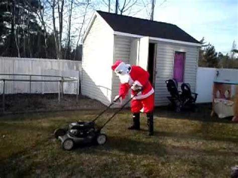 Santa Grass by Santa Claus Mowing Grass