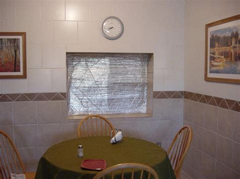 insulating patio doors for winter insulating window or door shutters using astrofoil 17