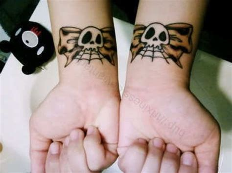 skull wrist tattoo designs skull bow ideas pickers