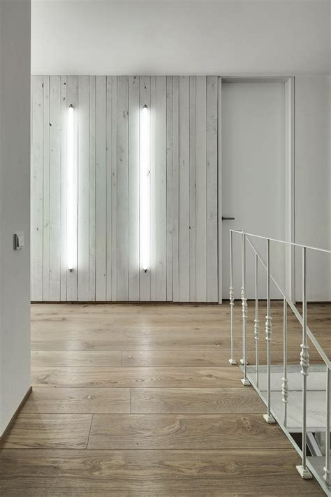 whitewashed wood paneling a bright white home with organic details