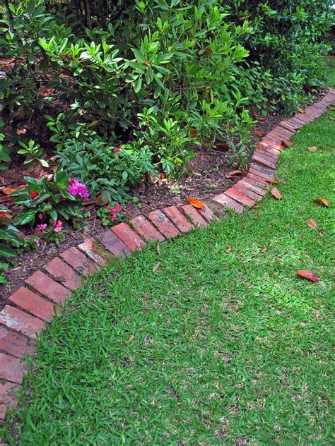 edging a flower bed how to keep grass out of a garden hgtv