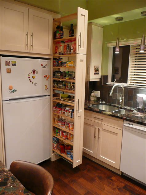 narrow pull out cabinet organizer the narrow cabinet beside the fridge pulls out to reveal a
