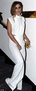 Cheryl cole is sleek in a white drape dress as she charms prince
