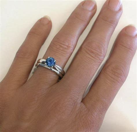 sapphire solitaire engagement ring and matching wedding