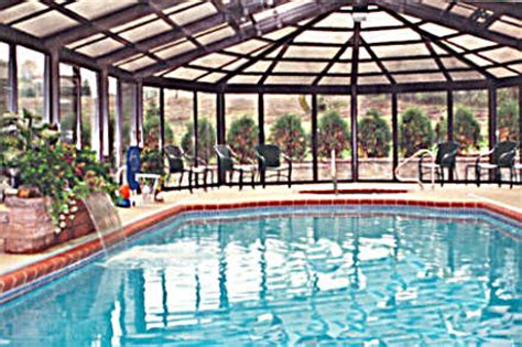 Octagon Houses residential pool enclosures gothic arch greenhouses
