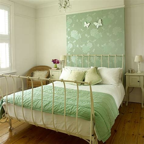 bedroom with green wallpaper panel decorating