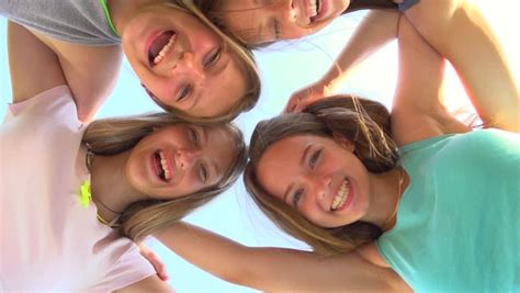 group teen girls laughing group of four teenage girls having fun outdoors