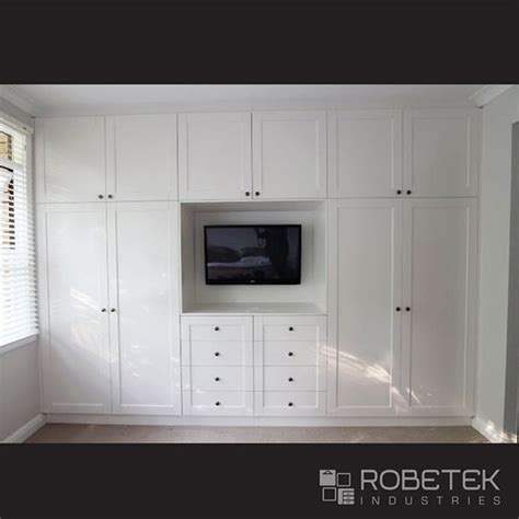 Wardrobe With Tv Unit by Best 25 Built In Wardrobe Ideas On