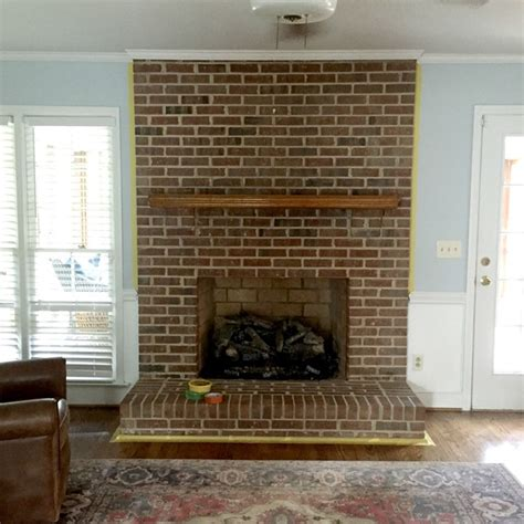 What To Do With Brick Fireplace by Painting Our Brick Fireplace White Emily A Clark