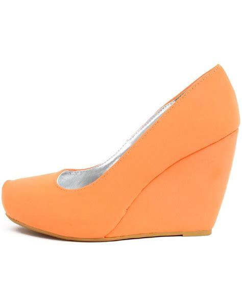 neon pastel orange wedge heels