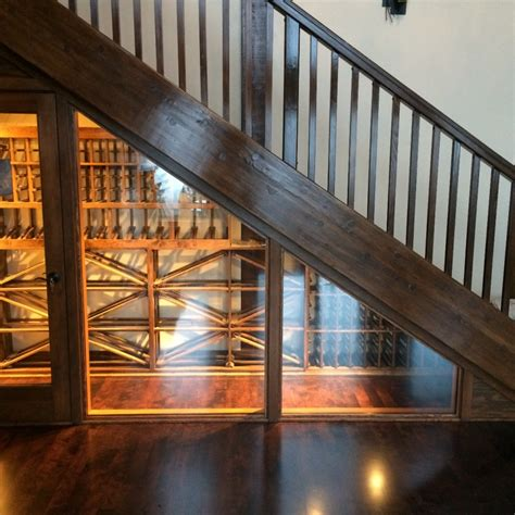 under stair wine cellar a small area under the stairs was brought to life by a