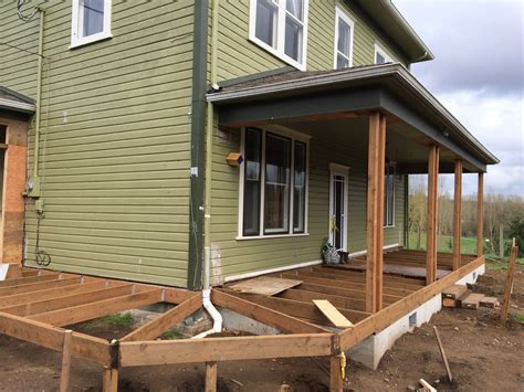 Framing A Front Porch the wood has been laid it s happening