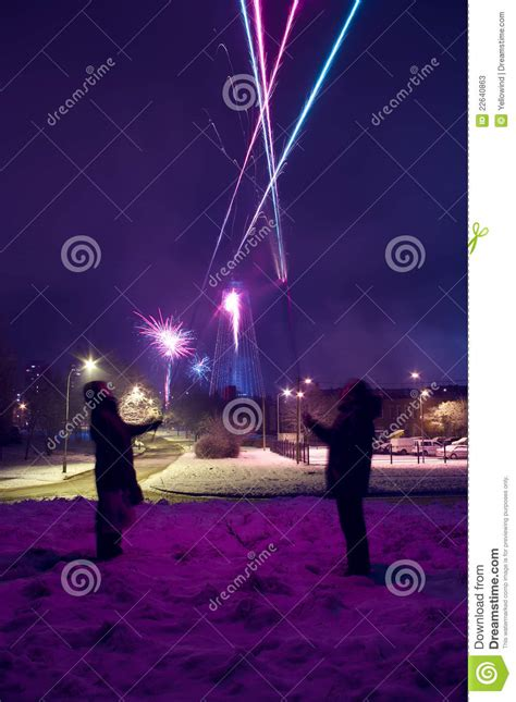 new years shooting pair is shooting fireworks at new years stock photos