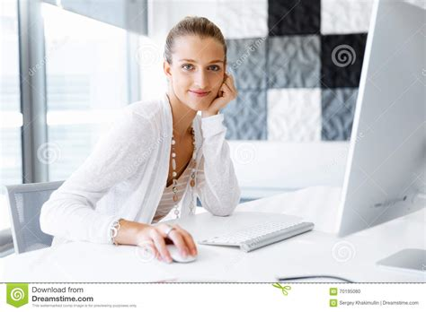 Office Worker At Desk Attractive Office Worker Sitting At Desk Stock Photo Image 70195080