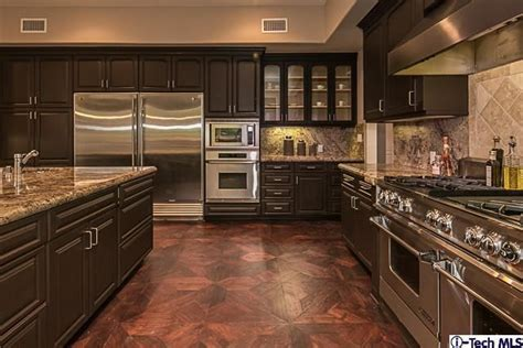 what color cabinets go with black appliances wide open kitchen with dark chocolate brown cabinets all