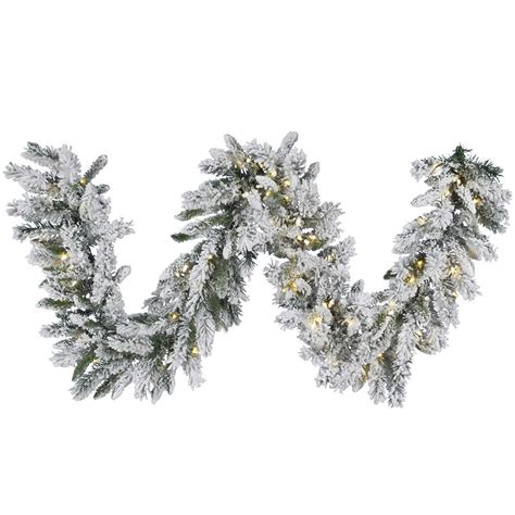 9 foot flocked snow ridge garland warm white led lights