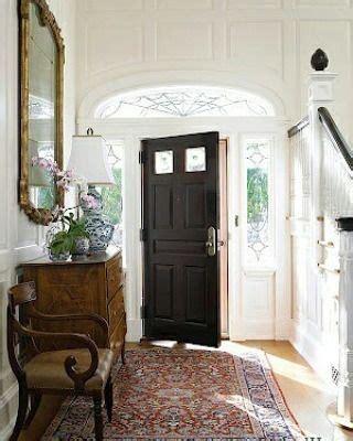 white walls  vintage brown  multicolored carpet