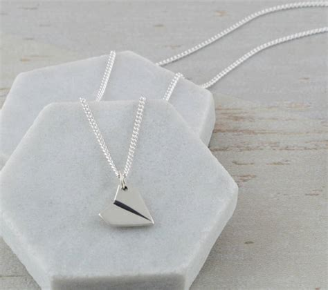 paper plane necklace sterling silver paper aeroplane necklace by suzy q designs
