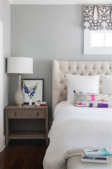 cream tufted bed cream linen tufted headboard under window transitional