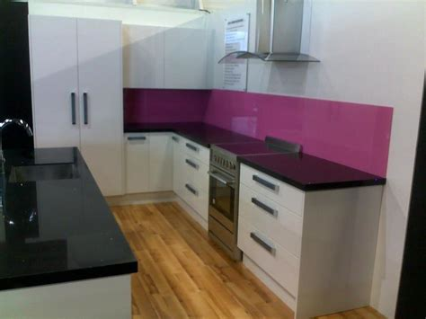 Designers Kitchens by Light Gloss Doors With Dark Top And Pink Splashback