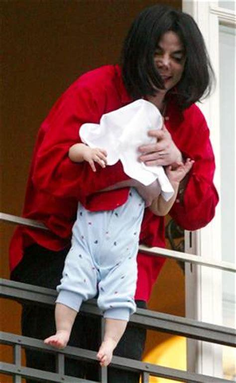 gerard butler swings fake baby over balcony, michael